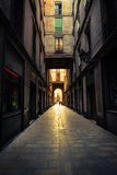 Straight narrow street in Gothic quarter Royalty Free Stock Photos