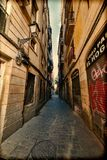 Straight narrow street in Gothic quarter Stock Photography