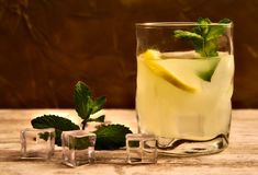 Glass of lemonade, ice cubes and peppermint royalty free stock image