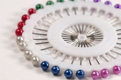 Straight pin collection. In a round plastic holder Royalty Free Stock Photo