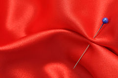 Straight Pin in Red Silk. Straight pin in a red satin Stock Photos