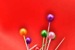 Straight Pins and Red Silk Stock Photo