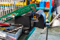 The straight pipe wrench and Bench Vise royalty free stock photography