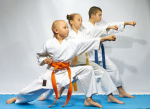 Straight punch arm are performing sportsmens on a blue mats Stock Photography