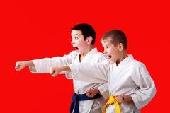 Straight punches hands in the performance of athletes in a kimono Stock Photo