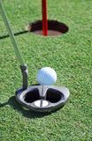 Straight putt. Golf putter and ball on green Stock Photography