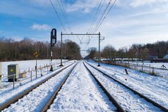 Railroad covered with snow Royalty Free Stock Image
