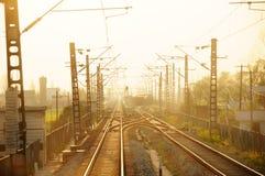 Straight railway bridge at sunset. Straight railway tracks at night Royalty Free Stock Image