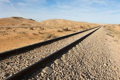 Straight Railway Tracks In The Desert Royalty Free Stock Images