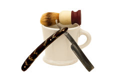 Straight razor with mug and brush Stock Image
