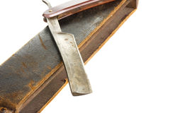 Straight razor with old leather belt Stock Photography