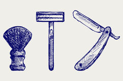Straight razor and shaving brush. Doodle style Royalty Free Stock Photos