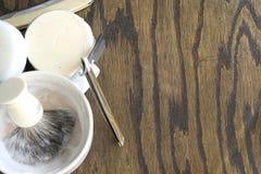 Straight razors with mug and cream background Stock Photos