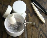 Straight razors with mug and cream background Royalty Free Stock Photography