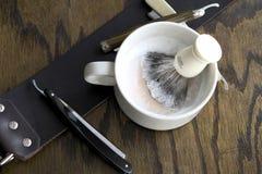 Straight razors with mug and cream Royalty Free Stock Image