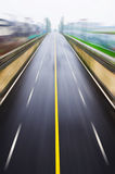 Straight road. With a yellow line,Motion blur Stock Photo