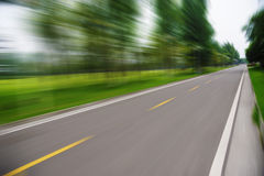 Straight road. With trees,Motion blur Royalty Free Stock Images