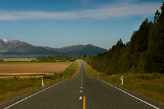 Straight road. A straight road crosses the center of New Zealand Royalty Free Stock Images