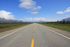 Straight road. Long straight road in Alaska, near Denali National Park Stock Photos