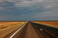 Straight road. Somewhere in outback of Australia Stock Images