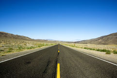 Straight Road. A straight road in the desert of USA Royalty Free Stock Photos