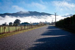 Straight road. The road goes straight away up to the mountains Royalty Free Stock Image