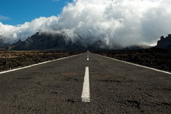 Straight road. A straight road across fields of lava at the Teide national park on Tenerife Royalty Free Stock Photos
