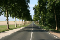 Straight road. D906 from Maintenon to Chartres in France. Vanishing point phenomenon Stock Photos