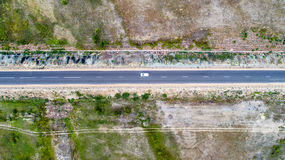 Straight road from above. Aerial view of a straight road in the valley Royalty Free Stock Photos