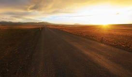 Straight road across the desert. In Iceland, Sunset HDR Stock Image