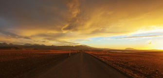 Straight road across the desert. In Iceland, Sunset HDR Royalty Free Stock Images