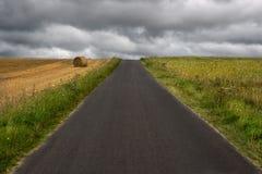 Straight road ahead. Under cloudy sky Royalty Free Stock Photos