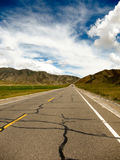 Straight road ahead with blue sky Stock Image