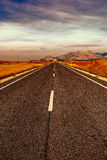 Straight Road. Asphalt Road in the Cantabrian Mountain at Sunset, Vintage Style Toned Picture Royalty Free Stock Photo