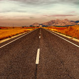 Straight Road. Asphalt Road in the Cantabrian Mountain at Sunset, Vintage Style Toned Picture Stock Photography