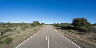 Straight road with blue sky Royalty Free Stock Images