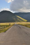 The straight road of Castelluccio plateau Royalty Free Stock Image