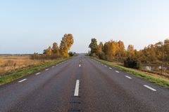 Straight road into a colorful landscape Royalty Free Stock Images