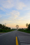 Straight road and colorful sunset. At thailand Royalty Free Stock Images