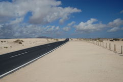 Straight road through the Correlejo sand dunes Stock Photo