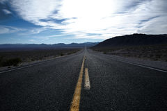 Straight road through Death Valley. Royalty Free Stock Images