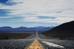 Straight road through Death Valley. Royalty Free Stock Photo