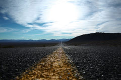 Straight road through Death Valley. Stock Photos