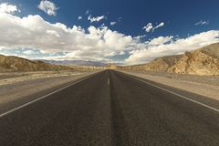 Straight road through Death Valley National Park Royalty Free Stock Image
