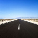 Straight road in desert. Cabo de Gata, Andalusia. Stock Image