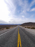 Straight road in desert landscape. In Nevada, United States Stock Images