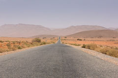 Straight road through the desert in Morocco, Africa Royalty Free Stock Photography
