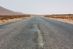 Straight road through the desert in Morocco, Africa Stock Photo