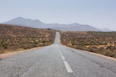 Straight road through the desert in Morocco, Africa Stock Photos