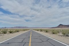 Straight road in desert. Straight road on desert landscape on Route 66, USA Stock Photo